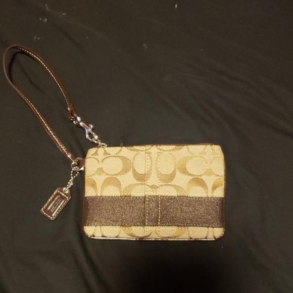 Coach Handbags - Small authentic Brown Coach Wristlet